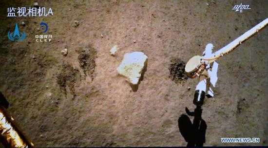 Photo provided by the China National Space Administration (CNSA) shows Chang'e-5 probe gathering samples on the moon on Dec. 2, 2020. China's Chang'e-5 probe has completed sampling on the moon, and the samples have been sealed within the spacecraft, the CNSA announced Thursday morning. (CNSA/Handout via Xinhua)