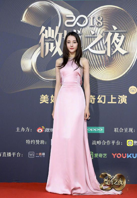 Chinese actress Dilraba Dilmurat poses as she arrives on the red carpet for the 2018 Weibo Night Ceremony in Beijing, China, Jan 11.