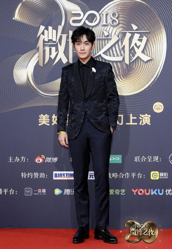 Chinese actor Zhu Yilong poses as he arrives on the red carpet for the 2018 Weibo Night Ceremony in Beijing, China, Jan 11.