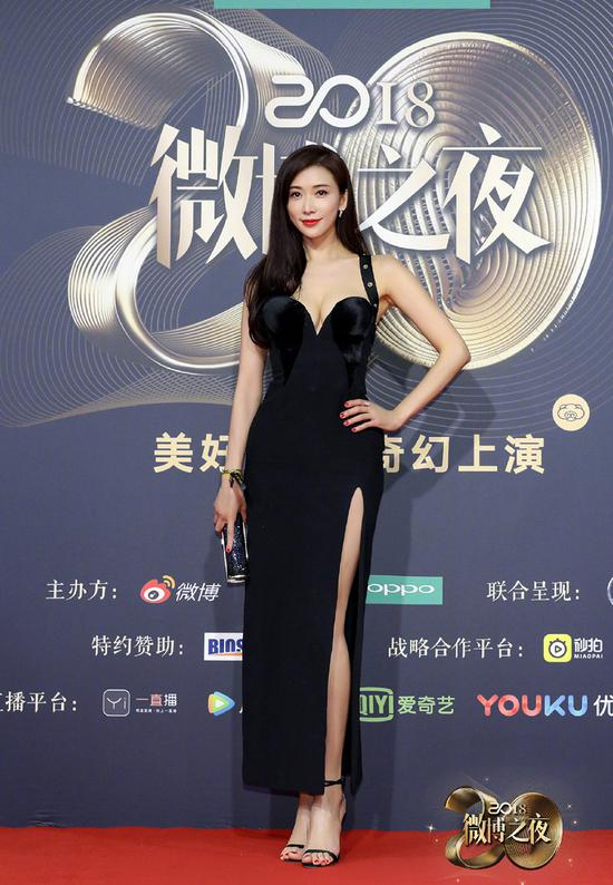 Chinese actress Lin Chi-ling poses as she arrives on the red carpet for the 2018 Weibo Night Ceremony in Beijing, China, Jan 11.