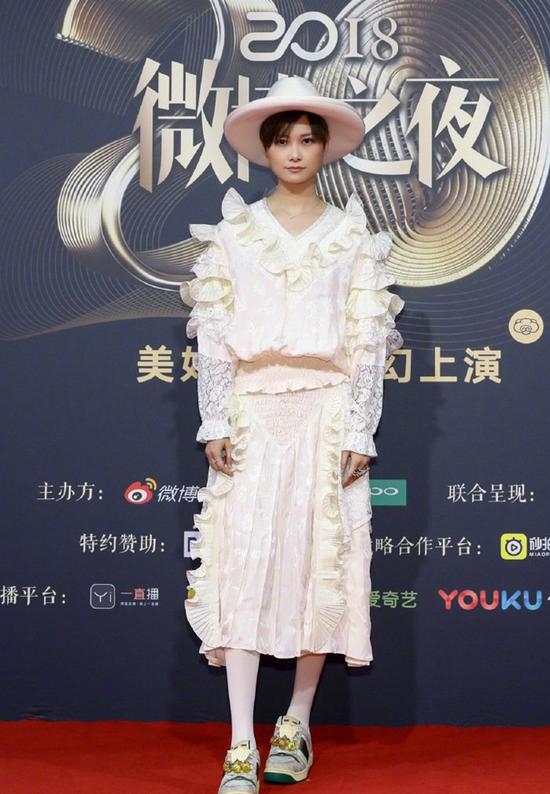 Chinese actress Li Yuchun poses as she arrives on the red carpet for the 2018 Weibo Night Ceremony in Beijing, China, Jan 11.