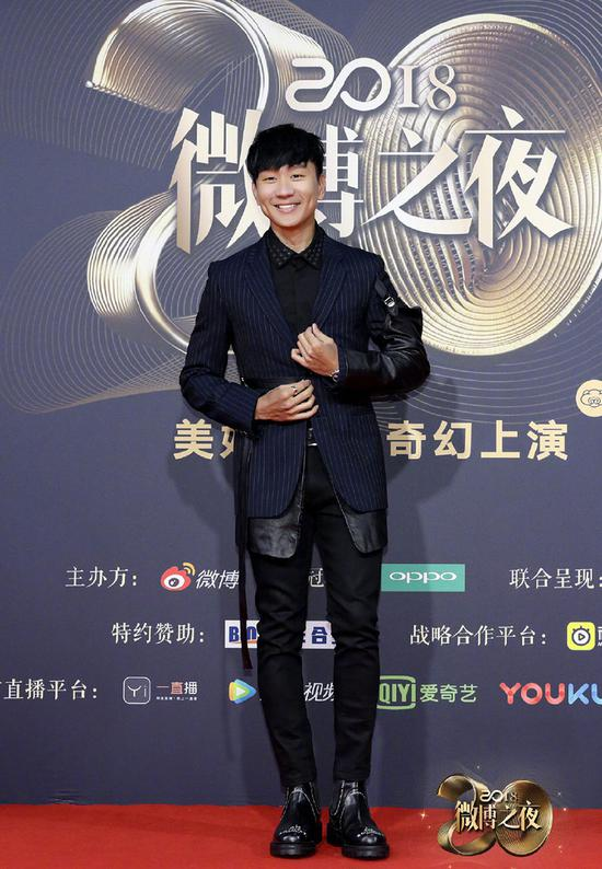 Singer JJ Lin poses as he arrives on the red carpet for the 2018 Weibo Night Ceremony in Beijing, China, Jan 11.
