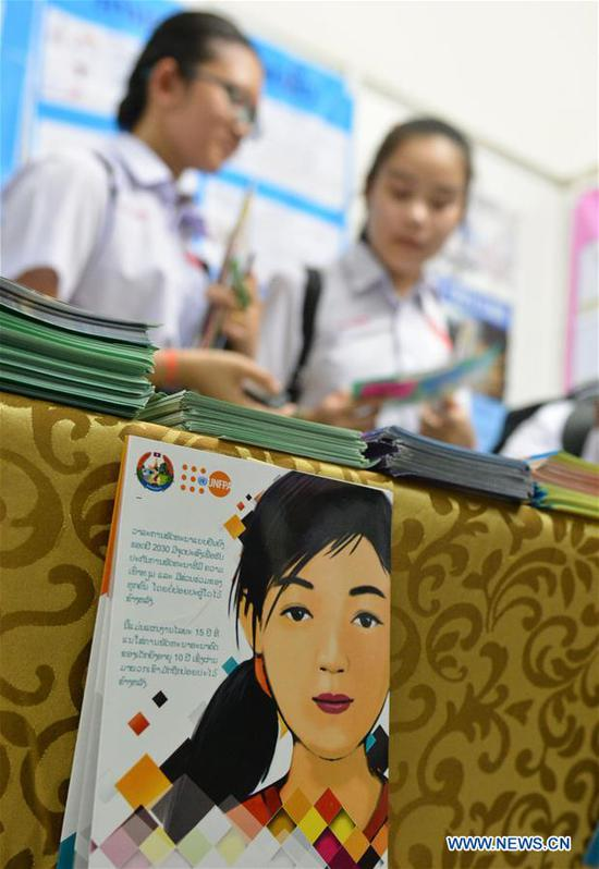 Students attend an activity to mark International Day of the Girl Child in Vientiane, capital of Laos, Oct. 11, 2018. (Xinhua/Liu Ailun)