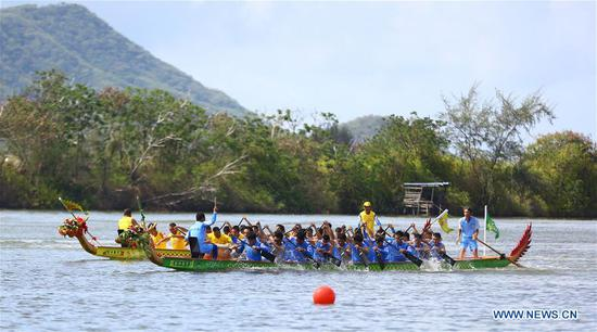 People take part in a dragon boat race to celebrate the Dragon Boat Festival at a Dahuwan Reservoir in Gaotai County of Zhangye City, northwest China's Gansu Province, on June 6, 2019. The Dragon Boat Festival falls on the fifth day of the fifth month of the Chinese lunar calendar, or June 7 this year. (Xinhua/Wang Jiang)
