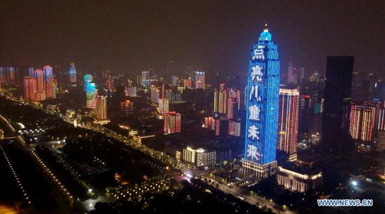 A building lights up blue on the occasion of World Children's Day in Wuhan, central China's Hubei Province, Nov. 20, 2020. Buildings and iconic monuments in some Chinese cities went blue on Friday to celebrate World Children's Day. World Children's Day is celebrated on November 20 each year to promote international togetherness, awareness among children worldwide, and improving children's welfare. (Xinhua/Xiong Qi)
