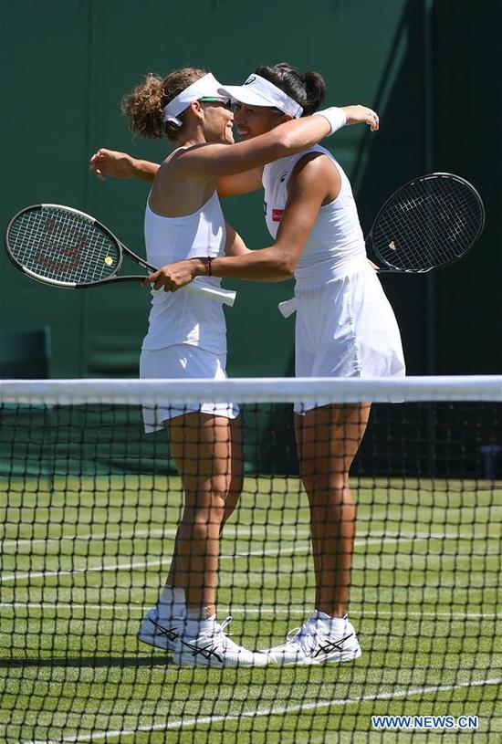 Zhang Shuai (R)/Samantha Stosur celebrate after the women's doubles first round match between Zhang Shuai of China/Samantha Stosur of Australia and Margarita Gasparyan/Alexandra Panova of Russia at the 2019 Wimbledon Tennis Championships in London, Britain, July 4, 2019. (Xinhua/Lu Yang)