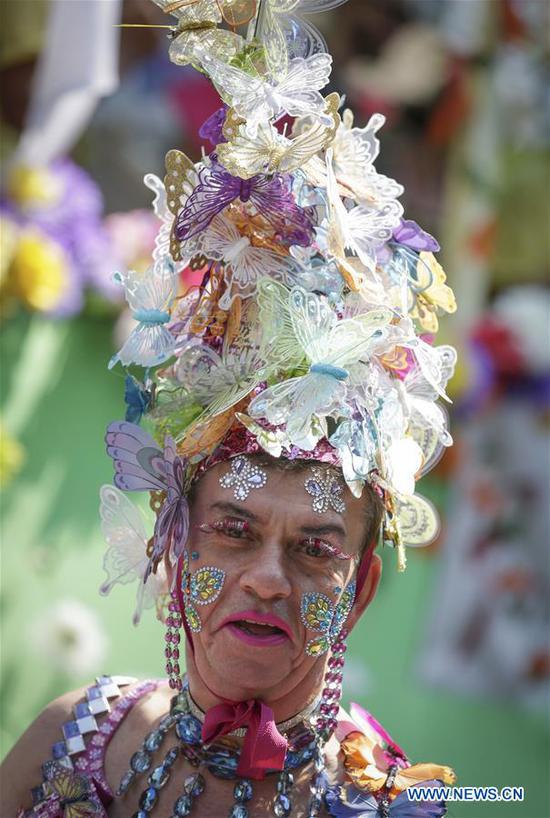 A reveller showcases his decorated costume during the 40th Vancouver Pride Parade in Vancouver, Canada, Aug. 5, 2018. (Xinhua/Liang Sen)
