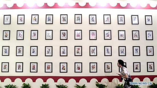 A visitor views stamp exhibits during the 2019 World Stamp Exhibition held in Wuhan, capital of central China's Hubei Province, June 11, 2019. The 2019 World Stamp Exhibition kicked off here on Tuesday. Nearly 4,700 exhibits from more than 80 countries and regions are showcased during the event. (Xinhua/Cheng Min)