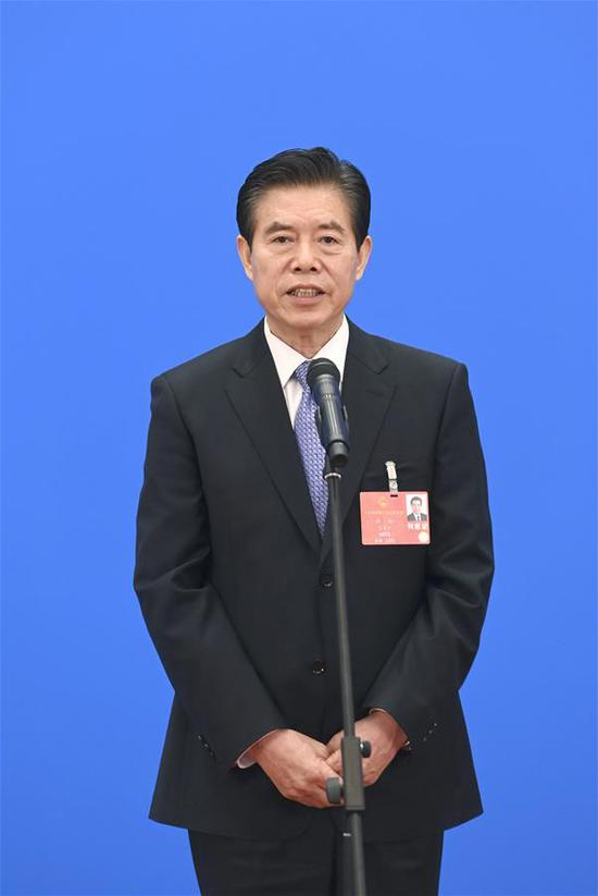 Chinese Minister of Commerce Zhong Shan gives an interview via video link after the second plenary meeting of the third session of the 13th National People's Congress (NPC) at the Great Hall of the People in Beijing, capital of China, May 25, 2020. (Xinhua/Chen Yehua)