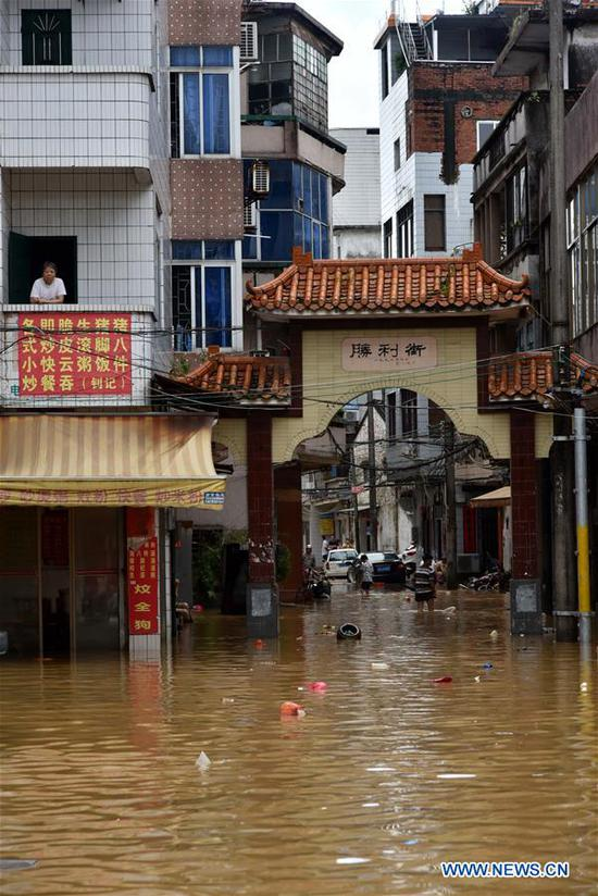 Photo taken on Sept. 18, 2018 shows a flooded street in Yangchun, south China's Guangdong Province. The city of Yangchun was hit by rainstorm after Super Typhoon Mangkhut ravaged Guangdong Province on Sunday. As of Tuesday, part of the city is still flooded, while disaster relief work is underway. (Xinhua/Zhou Ke)