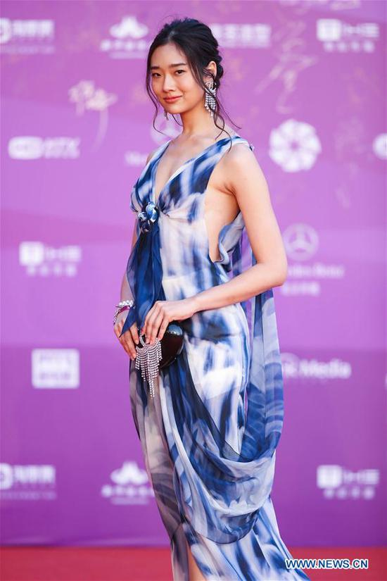 Chutimon Chuengcharoensukying poses on the red carpet before the opening ceremony of the 8th Beijing International Film Festival (BJIFF) in Beijing, capital of China, April 15, 2018. (Xinhua/Cai Yang)