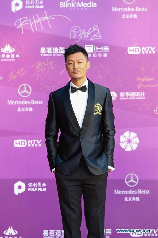 Shawn Yue poses on the red carpet before the opening ceremony of the 8th Beijing International Film Festival (BJIFF) in Beijing, capital of China, April 15, 2018. (Xinhua/Cai Yang)