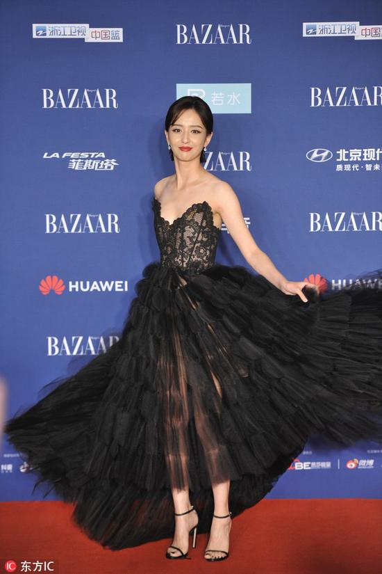Chinese actress Tong Liya arrives on the red carpet for the 2018 Bazaar Star Charity Night Gala in Beijing, China, Oct 12, 2018. [Photo/IC]