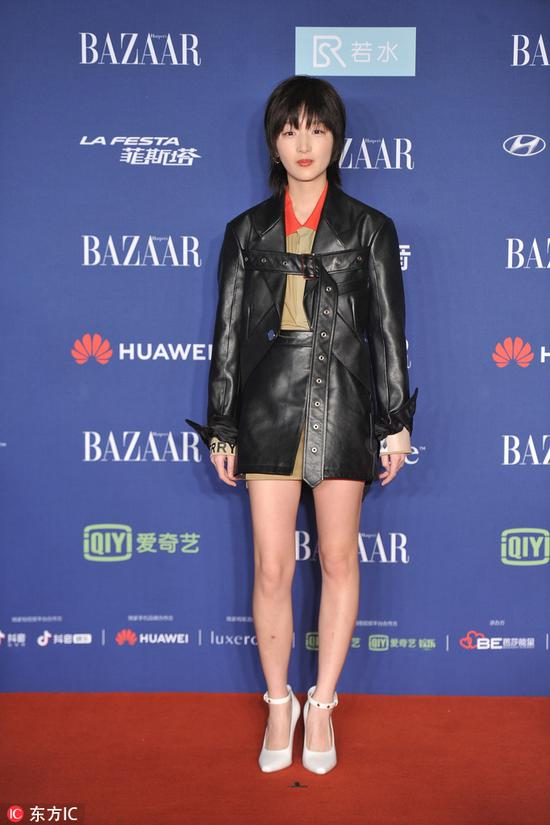Chinese actress Zhou Dongyu arrives on the red carpet for the 2018 Bazaar Star Charity Night Gala in Beijing, China, Oct 12, 2018. [Photo/IC]