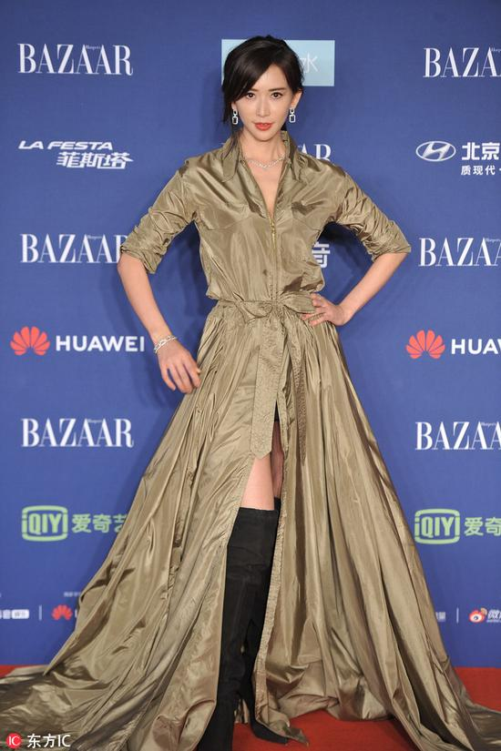 Chinese actress-model Lin Chi-ling arrives on the red carpet for the 2018 Bazaar Star Charity Night Gala in Beijing, China, Oct 12, 2018. [Photo/IC]