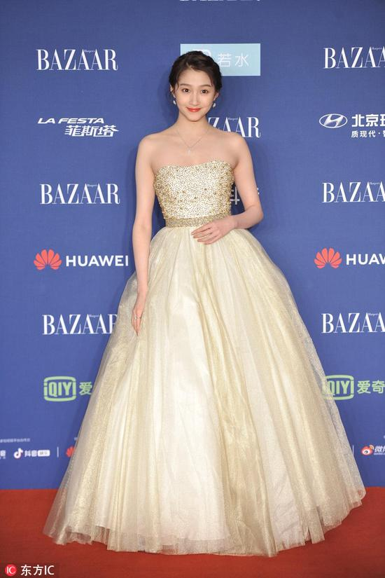Chinese actress Guan Xiaotong arrives on the red carpet for the 2018 Bazaar Star Charity Night Gala in Beijing, China, Oct 12, 2018. [Photo/IC]