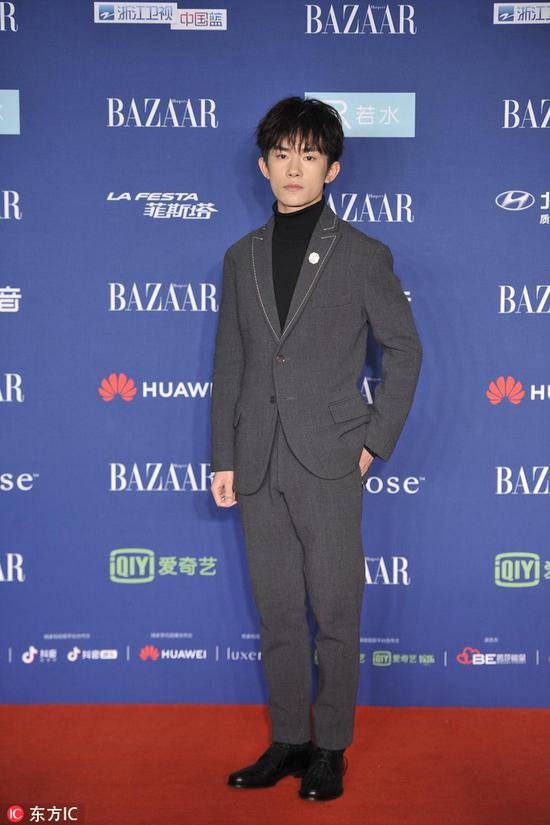 Chinese star Yi Yangqianxi arrives on the red carpet for the 2018 Bazaar Star Charity Night Gala in Beijing, China, Oct 12, 2018. [Photo/IC]