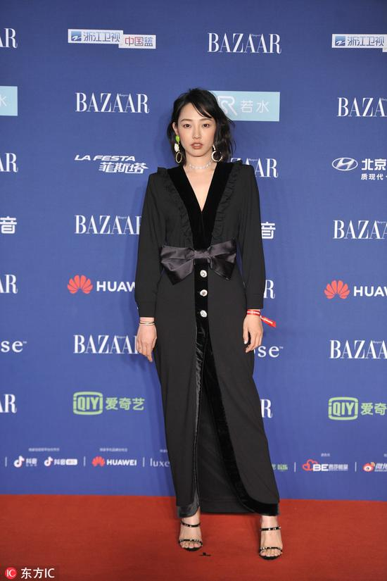 Chinese actress Bai Baihe arrives on the red carpet for the 2018 Bazaar Star Charity Night Gala in Beijing, China, Oct 12, 2018. [Photo/IC]