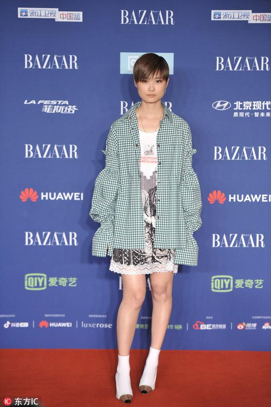 Chinese actress-singer Li Yuchun arrives on the red carpet for the 2018 Bazaar Star Charity Night Gala in Beijing, China, Oct 12, 2018. [Photo/IC]