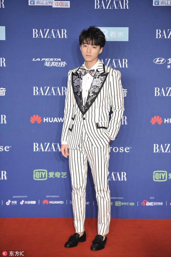 Chinese star Wang Junkai arrives on the red carpet for the 2018 Bazaar Star Charity Night Gala in Beijing, China, Oct 12, 2018. [Photo/IC]