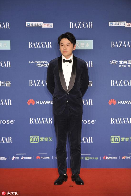 Chinese actor Lei Jiayin arrives on the red carpet for the 2018 Bazaar Star Charity Night Gala in Beijing, China, Oct 12, 2018. [Photo/IC]