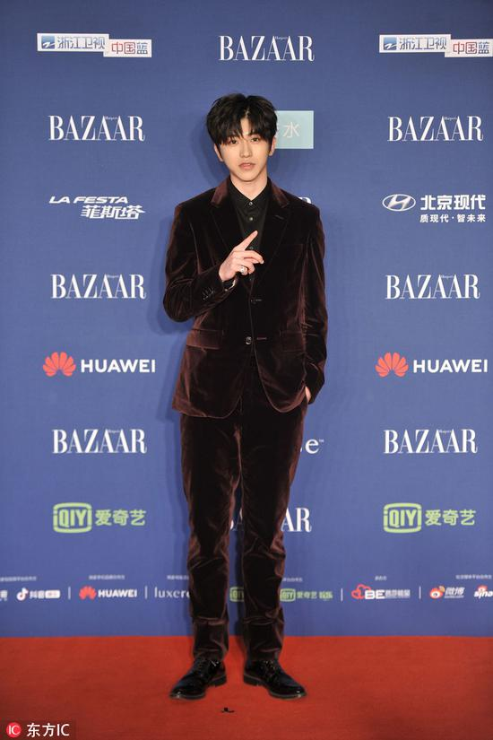 Chinese star Cai Xukun arrives on the red carpet for the 2018 Bazaar Star Charity Night Gala in Beijing, China, Oct 12, 2018. [Photo/IC]