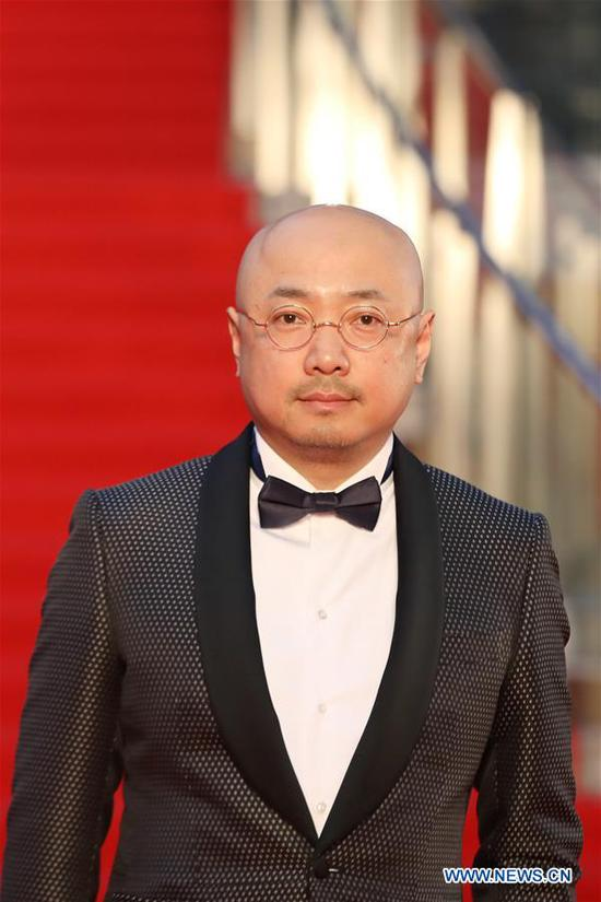 Chinese actor Xu Zheng is pictured on the red carpet for the opening ceremony of the 31st Tokyo International Film Festival, Tokyo, Japan, Oct. 25, 2018. (Xinhua/Du Xiaoyi)