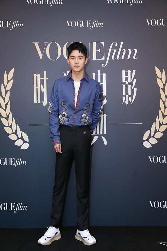 Chinese actor Liu Haoran arrives on the red carpet for the Vogue Film fashion event 2018 in Beijing, China, Nov 7, 2018. [Photo/IC]