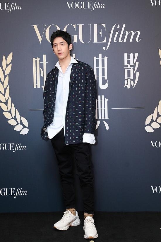 Chinese actor Jing Boran arrives on the red carpet for the Vogue Film fashion event 2018 in Beijing, China, Nov 7, 2018. [Photo/IC]