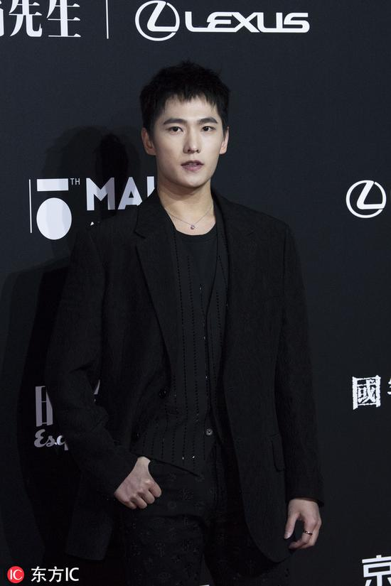 Chinese actor Yang Yang poses as he arrives for the 15th Esquire Men At His Best (MAHB) Award 2018 in Beijing, China, December 4, 2018. [Photo/IC]