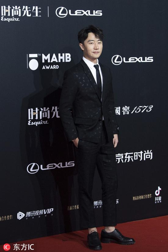 Chinese actor Huang Xuan poses as he arrives for the 15th Esquire Men At His Best (MAHB) Award 2018 in Beijing, China, December 4, 2018. [Photo/IC]