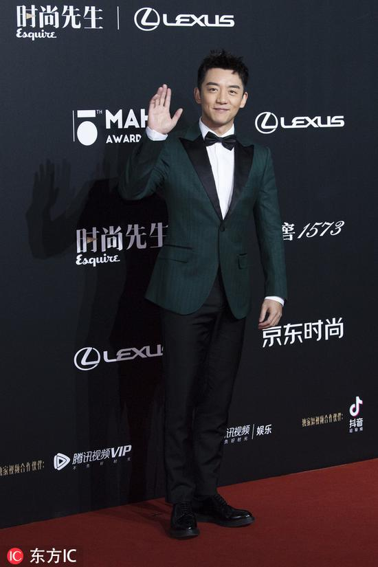 Chinese actor Zheng Kai poses as he arrives for the 15th Esquire Men At His Best (MAHB) Award 2018 in Beijing, China, December 4, 2018. [Photo/IC]