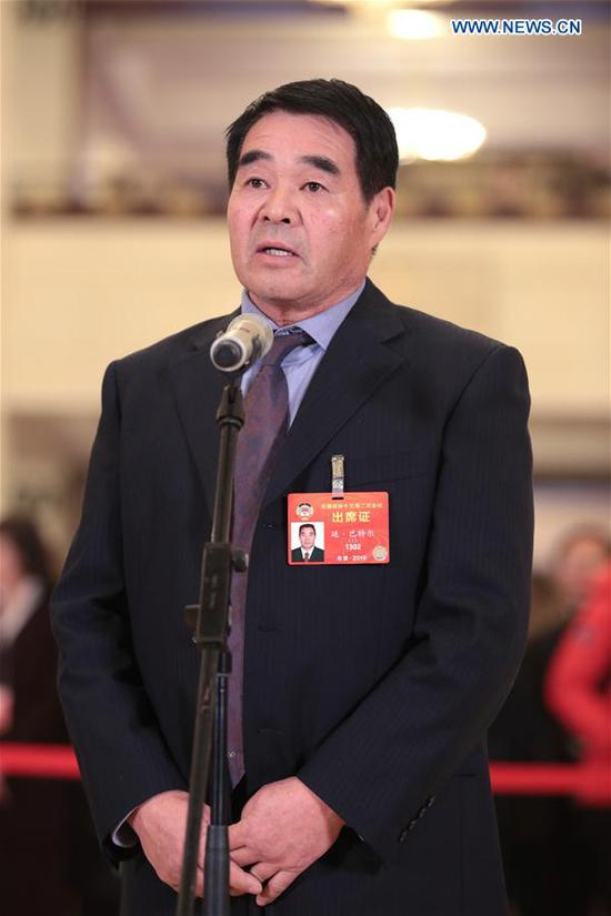 Ting Bateer, a member of the 13th National Committee of the Chinese People's Political Consultative Conference (CPPCC), receives an interview ahead of the second plenary meeting of the second session of the 13th CPPCC National Committee at the Great Hall of the People in Beijing, capital of China, March 9, 2019. (Xinhua/Cai Yang)