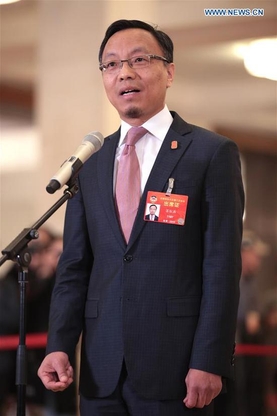 Lyu Hongbing, a member of the 13th National Committee of the Chinese People's Political Consultative Conference (CPPCC), receives an interview ahead of the second plenary meeting of the second session of the 13th CPPCC National Committee at the Great Hall of the People in Beijing, capital of China, March 9, 2019. (Xinhua/Cai Yang)