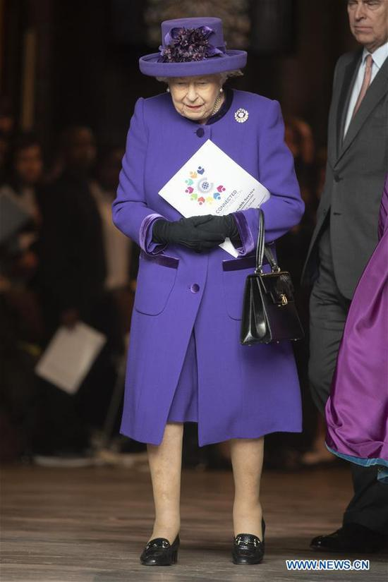 Britain's Queen Elizabeth II leaves after attending the Commonwealth Day celebrations at Westminster Abbey in London, Britain, on March 11, 2019. (Xinhua/Ray Tang)