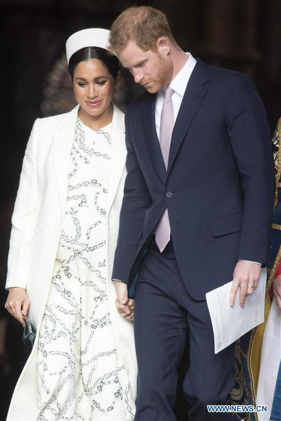 Britain's Prince Harry (R), Duke of Sussex, and his wife Meghan, Duchess of Sussex, leave after attending the Commonwealth Day celebrations at Westminster Abbey in London, Britain, on March 11, 2019. (Xinhua/Ray Tang)