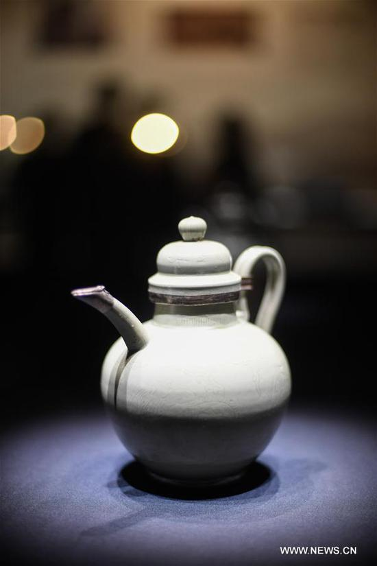 Photo taken on Nov. 14, 2019 shows a piece of celadon porcelain work during a Yue kiln 's celadon porcelain exhibition at Cixi Museum in Cixi, east China's Zhejiang Province. More than 40 pieces of celadon porcelain from different cultural units are displayed during the exhibition, which will last till Feb. 1, 2020. (Xinhua/Huang Zongzhi)