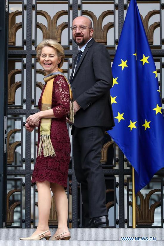 European Council President Charles Michel (R) and European Commission President Ursula von der Leyen prepare to attend a ceremony to mark the 10th anniversary of the entry into force of the Lisbon Treaty, at the House of European History in Brussels, Belgium, Dec. 1, 2019. (Xinhua/Zhang Cheng)