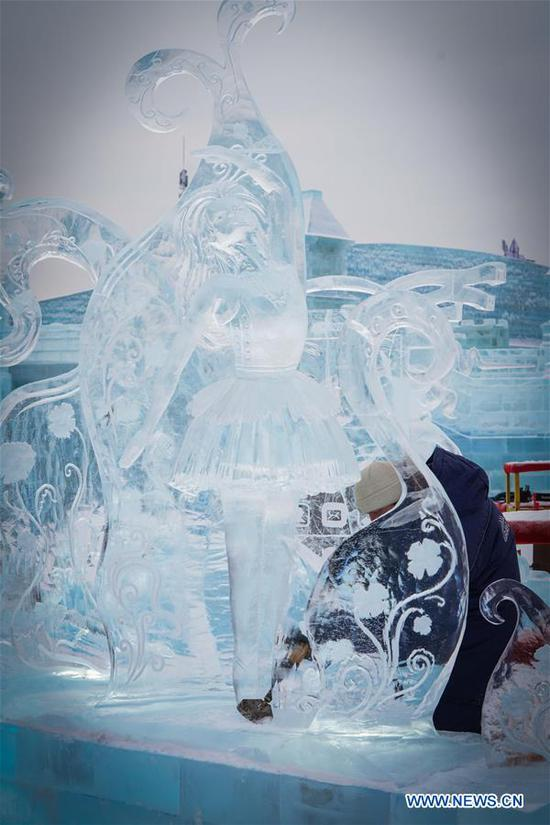 A competitor from Russia creates a work which ends up at the third place during the 34th Harbin International Ice Sculpture Competition in the Harbin Ice and Snow World in Harbin, northeast China's Heilongjiang Province, Jan. 8, 2020. The 34th Harbin International Ice Sculpture Competition concluded in Harbin on Wednesday. The ice sculpture made by a Russian team won the first prize at the end of the competition. (Xinhua/Wang Song)