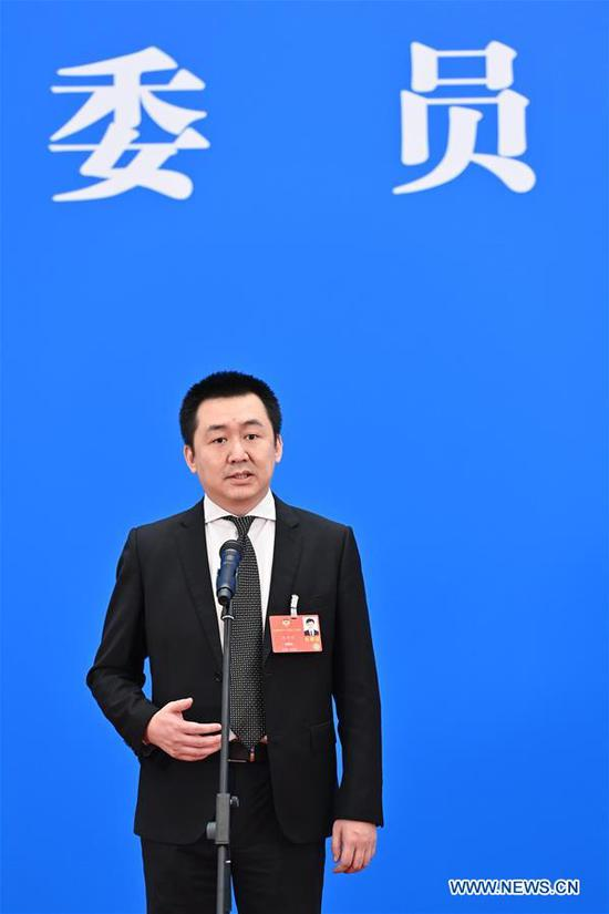 Wang Xiaochuan, a member of the 13th National Committee of the Chinese People's Political Consultative Conference (CPPCC), gives an interview via video link ahead of the closing meeting of the third session of the 13th CPPCC National Committee at the Great Hall of the People in Beijing, capital of China, May 27, 2020. (Xinhua/Liu Jinhai)