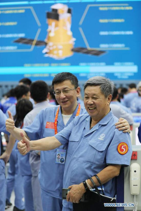 Technicians celebrate the successful launch of the Chang'e-5 spacecraft at the Wenchang Spacecraft Launch Site in south China's Hainan Province, Nov. 24, 2020. China on Tuesday launched a spacecraft to collect and return samples from the moon, the country's first attempt to retrieve samples from an extraterrestrial body. (Xinhua/Jin Liwang)