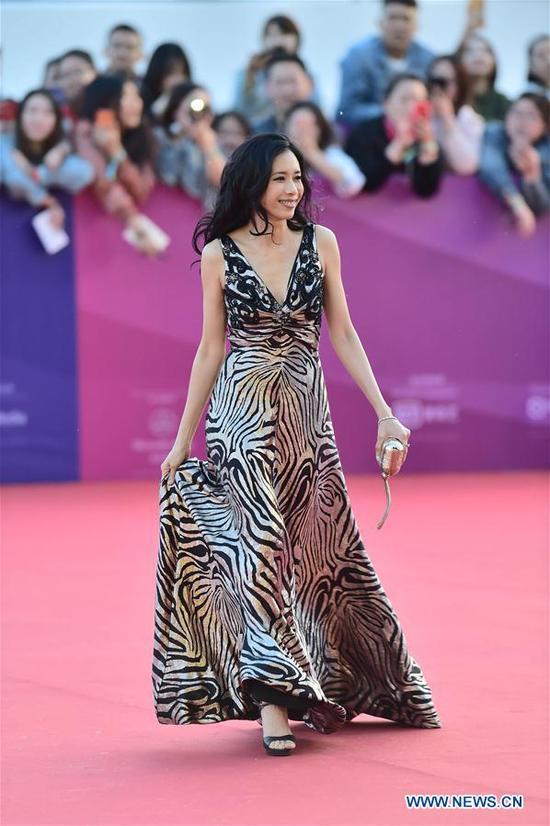 Karen Mok poses on the red carpet before the opening ceremony of the 8th Beijing International Film Festival (BJIFF) in Beijing, capital of China, April 15, 2018. (Xinhua/Liu Jinhai)