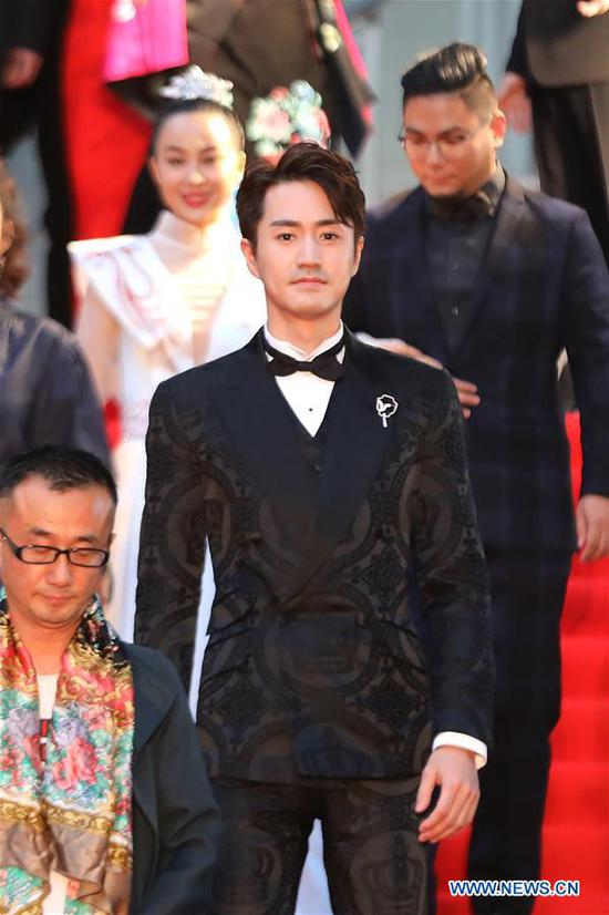 Chinese actor Yang Le is pictured on the red carpet for the opening ceremony of the 31st Tokyo International Film Festival, Tokyo, Japan, Oct. 25, 2018. (Xinhua/Du Xiaoyi)