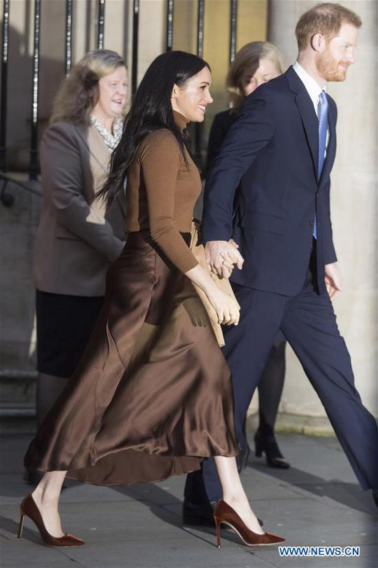 Prince Harry, Duke of Sussex and Meghan, Duchess of Sussex, depart after a visit at Canada House in London, Britain on Jan. 7, 2020. The Duke and Duchess of Sussex's intention to step back from royal life dominated newspaper headlines in Britain Thursday. (Photo by Ray Tang/Xinhua)
