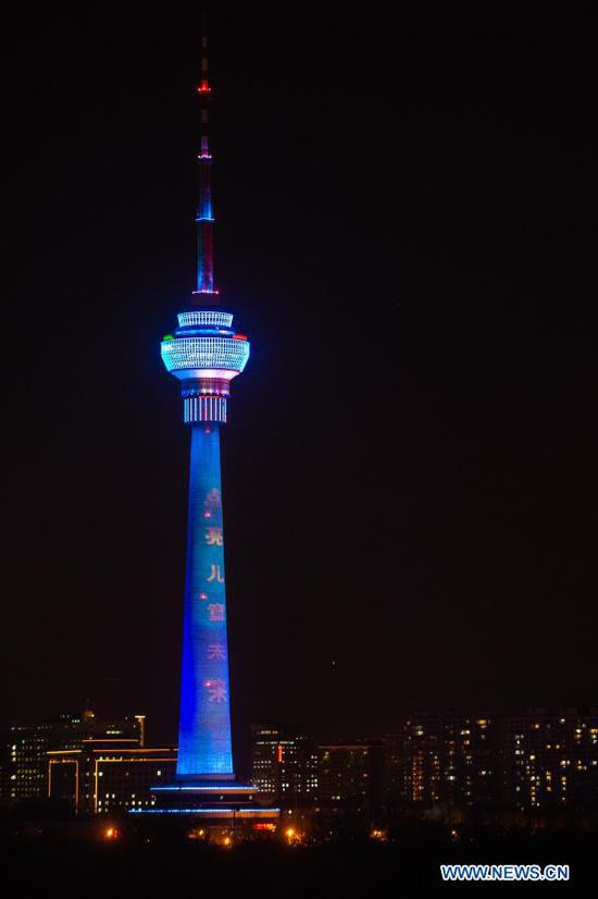 The Central Radio & TV Tower lights up blue on the occasion of World Children's Day in Beijing, capital of China, Nov. 20, 2020. Buildings and iconic monuments in some Chinese cities went blue on Friday to celebrate World Children's Day. World Children's Day is celebrated on November 20 each year to promote international togetherness, awareness among children worldwide, and improving children's welfare. (Xinhua/Chen Zhonghao)
