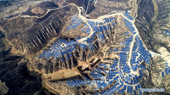 Aerial photo taken on Nov. 7, 2018 shows a photovoltaic power station built under an inter-village poverty relief program in Huojiaping Village of Yihe Township, Suide County, northwest China's Shaanxi Province. Located on the Loess Plateau, Suide County has abundant sunshine and idle lands which are ideal for the construction of photovoltaic power stations. Currently, local authorities are working with a provincial branch of electricity service provider State Grid on a 33-megawatt photovoltaic power station. (Xinhua/Liu Xiao)