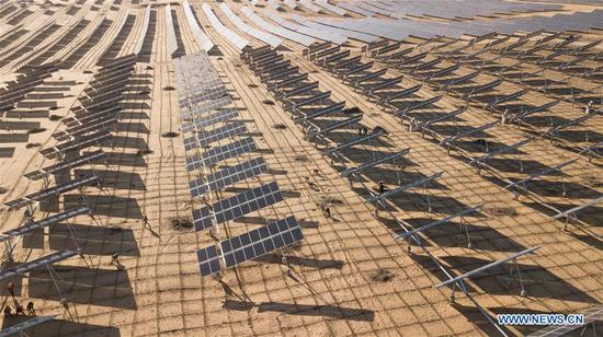 Aerial photo taken on March 13, 2018 shows the photovoltaic power station built at the Kubuqi Desert in north China's Inner Mongolia Autonomous Region. Kubuqi, the seventh largest desert in China, is a good example of China's success in alleviating desertification. (Xinhua/Peng Yuan)