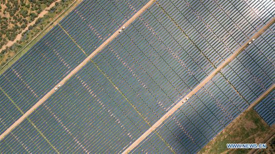 Aerial photo taken on Dec. 13, 2019 shows the 50 MW solar power farm in Garissa, Kenya. The plant, designed and built by the EPC contractor China Jiangxi Corporation for International Economic and Technical Co-operation (CJIC), in conjunction with Kenya's Rural Energy Authority (REA), is one of the largest photovoltaic electricity stations in Africa. (Xinhua/Xie Han)