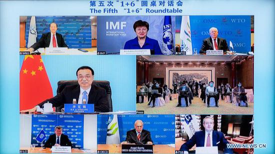 "Chinese Premier Li Keqiang and leaders of six major international economic institutions jointly meet the press via video link after the fifth ""1+6"" Roundtable, in Beijing, on Nov. 24, 2020. (Xinhua/Zhai Jianlan)"