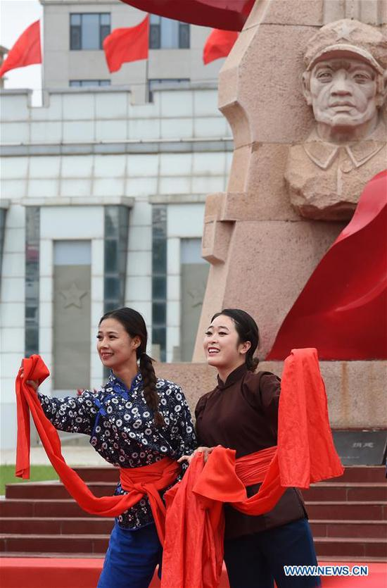Artists perform during an event marking the conclusion of an activity that took journalists to retrace the route of the Long March, in Huining, northwest China's Gansu Province, Aug. 18, 2019. The activity, held from June 11 to Aug. 18, was aimed at paying tribute to the revolutionary martyrs and passing on the traditions of revolution. The Long March was a military maneuver carried out by the Chinese Workers' and Peasants' Red Army from 1934 to 1936. During this period, they left their bases and marched through rivers, mountains and arid grassland to break the siege of Kuomintang forces and continue to fight Japanese aggressors. Many marched as far as 12,500 km. (Xinhua/Ma Ning)